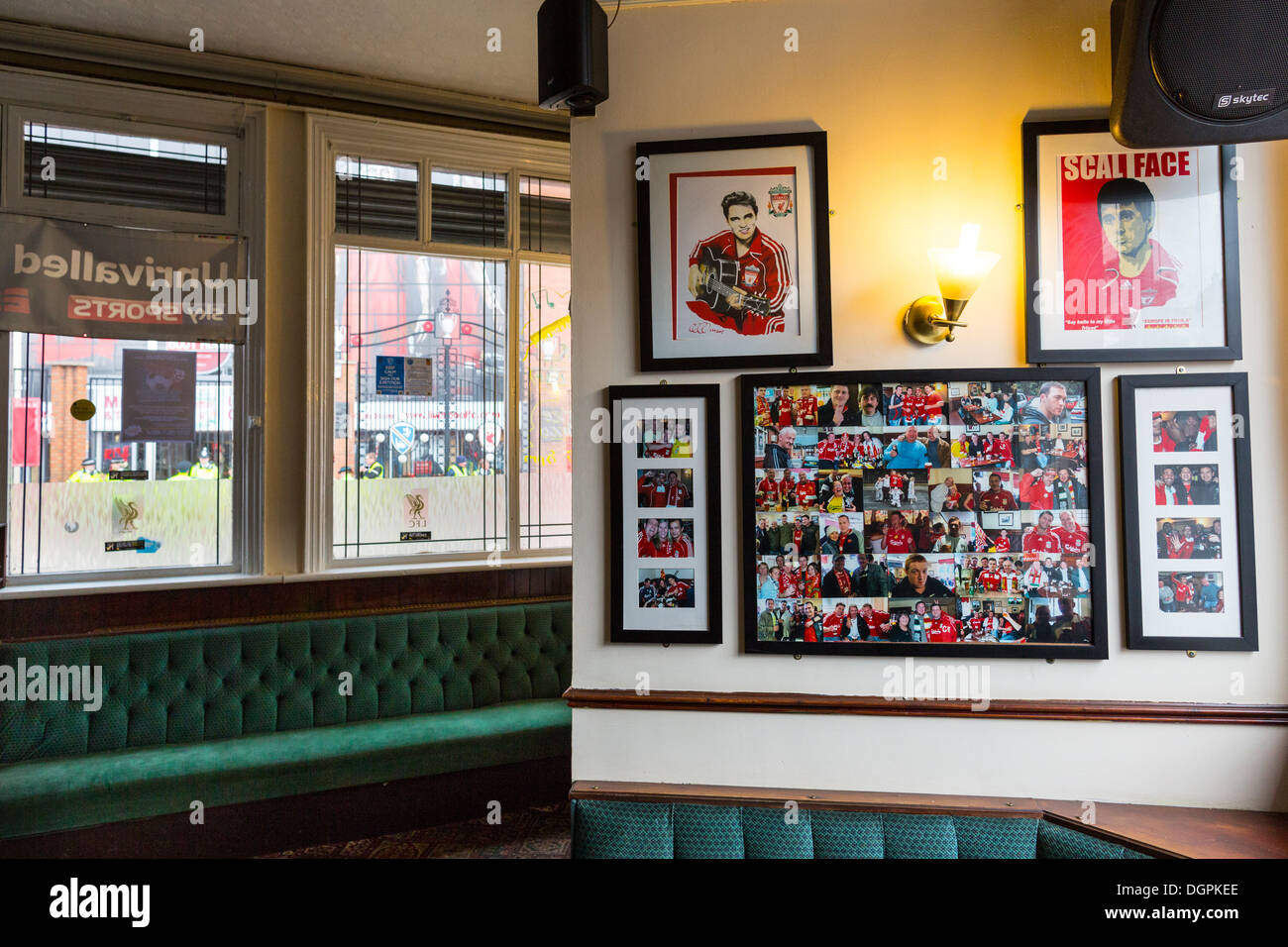 Pictures decorate the walls of The Park public house opposite The Kop, Anfield, Liverpool, UK - Stock Image