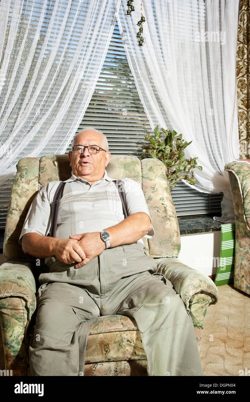 Elderly man sitting in a recliner Stock Photo: 61965012 - Alamy