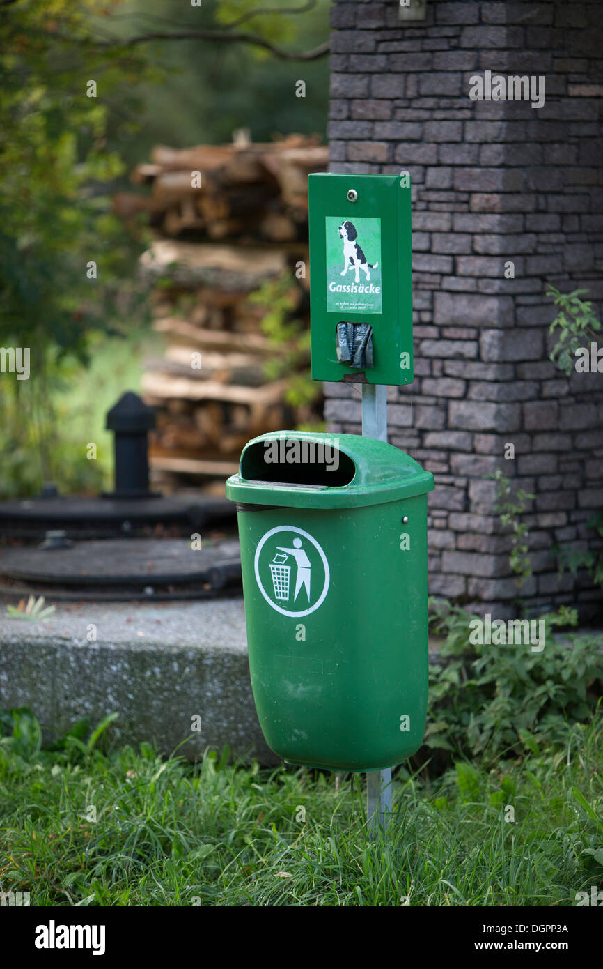 Garbage bin with organic dog waste bags in the Weissensee Nature Park, Carinthia, Austria, Europe - Stock Image