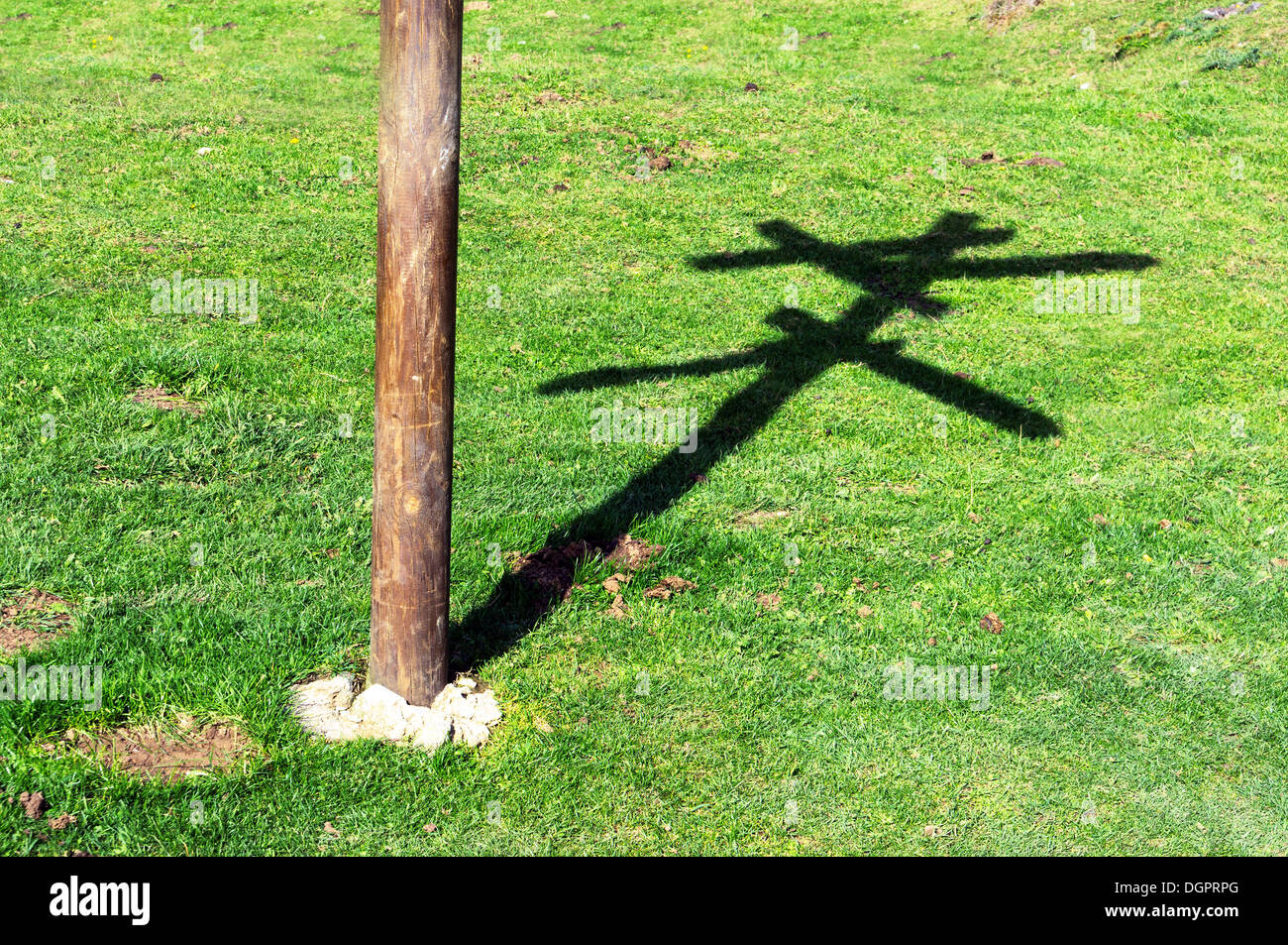 crossroads with the shadow of wooden signpost - Stock Image