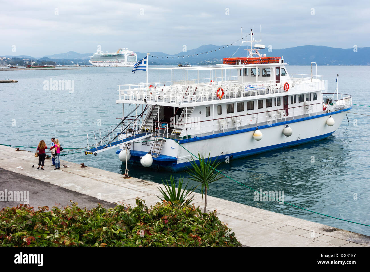 Boat trip, ferry boat tourism on water, Bay of Corfu -  Old Town, Corfu Island, Ionian Islands, Greek Islands, Greece, Europe. - Stock Image