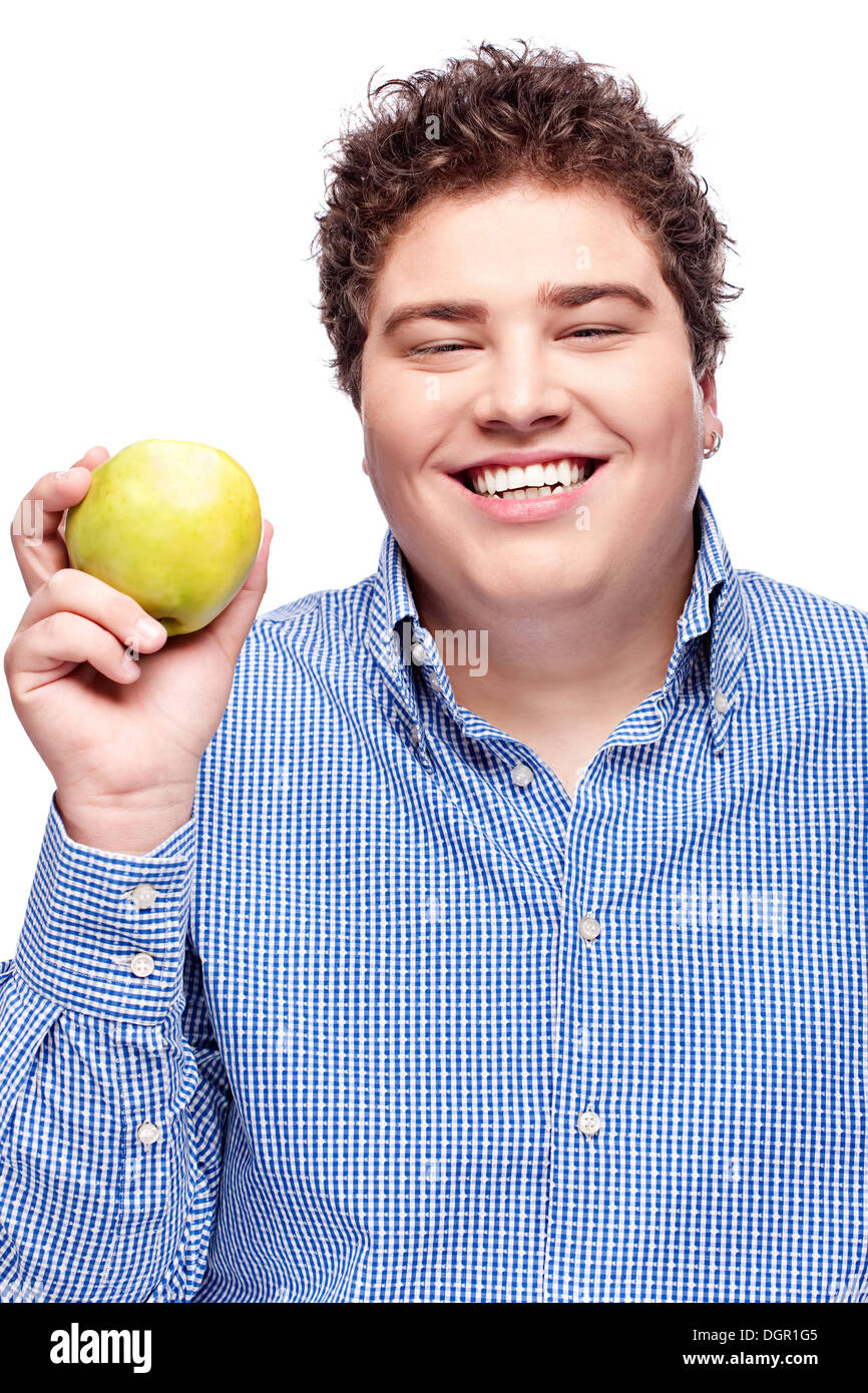 Happy chubby man holding apple, isolated on white - Stock Image