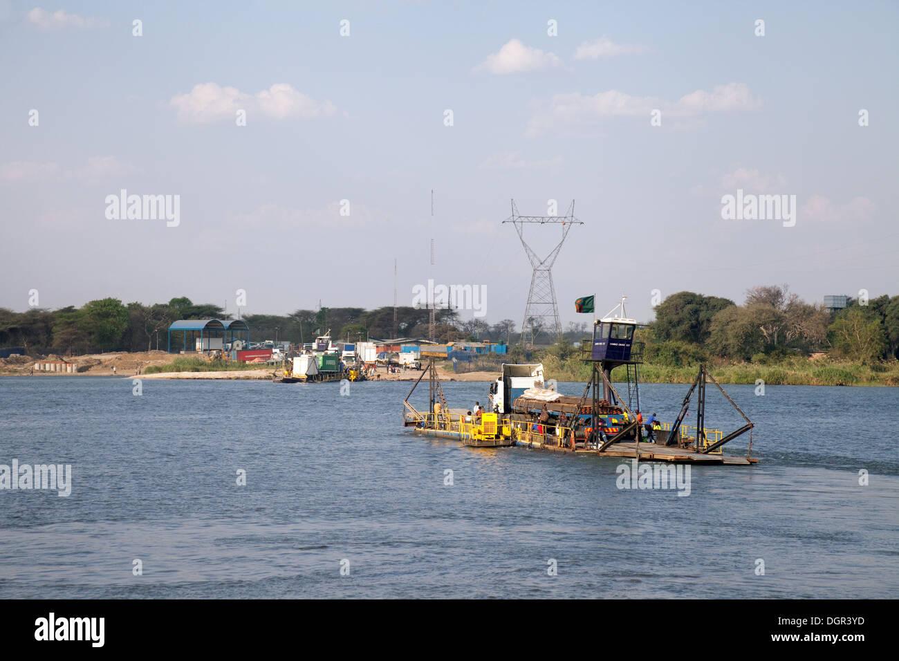 The Kazungula ferry transporting goods and people across the Zambezi river from Botswana to Zambia, Africa - Stock Image
