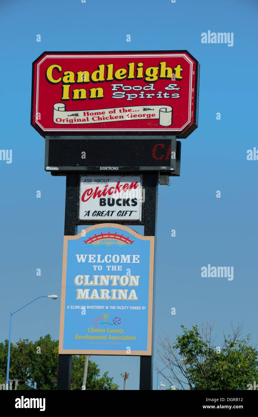 Sign for the Candlelight Inn, a popular restaurant along the Mississippi River, in Clinton, Iowa - Stock Image