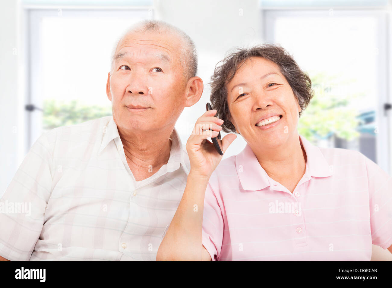 happy seniors couple talking on the phone - Stock Image