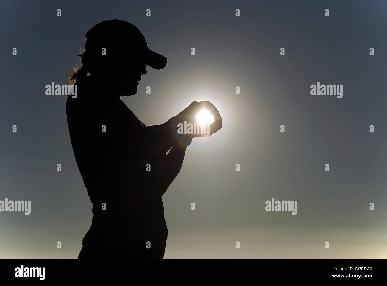 Woman holding her hands around the Sun, Nasca, Atacama Desert, Peru, South America - Stock Image