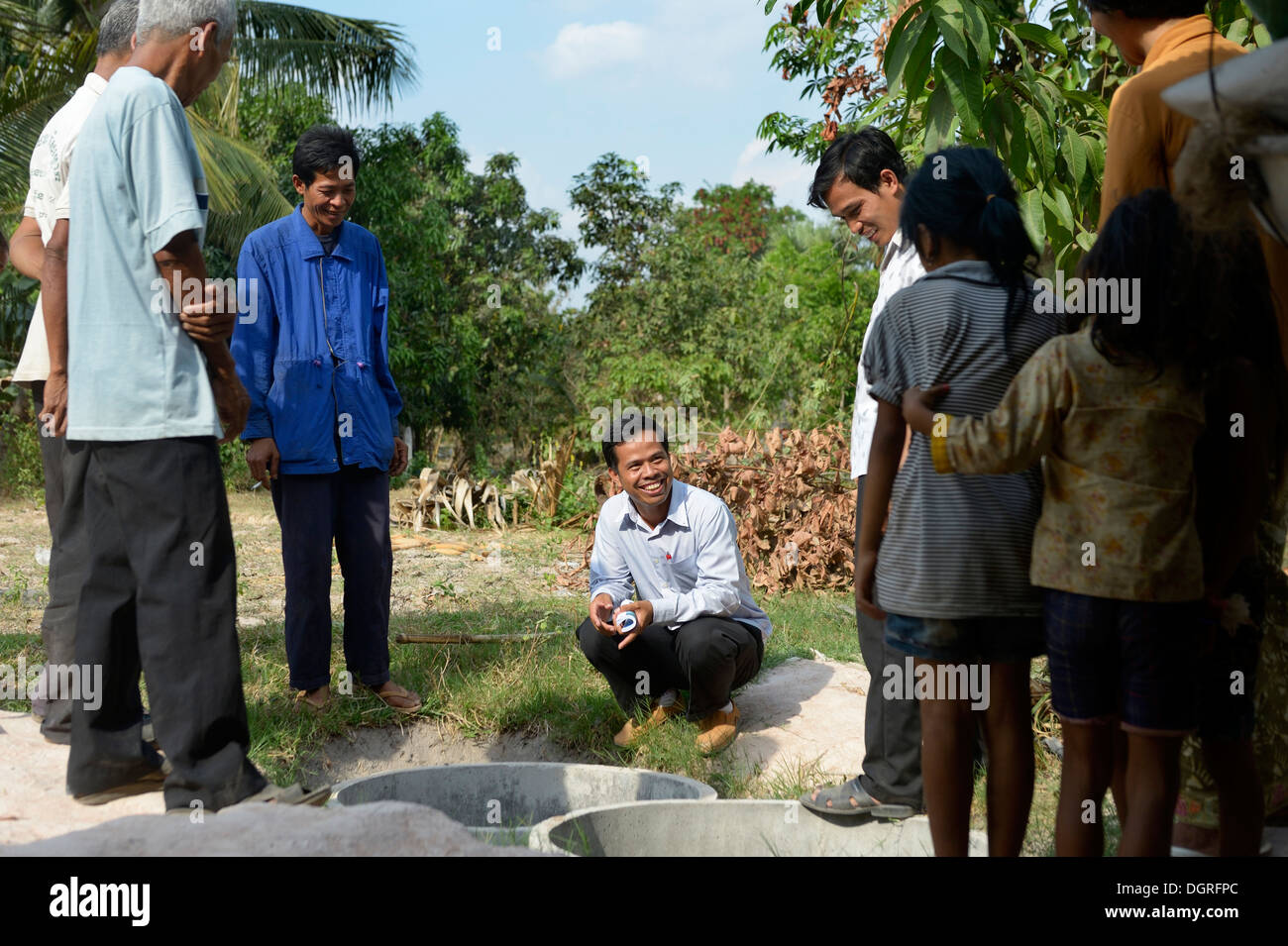 Cambodia, Takeo Province, Members of aid organisation discussing improvements of water supply with villagers - Stock Image