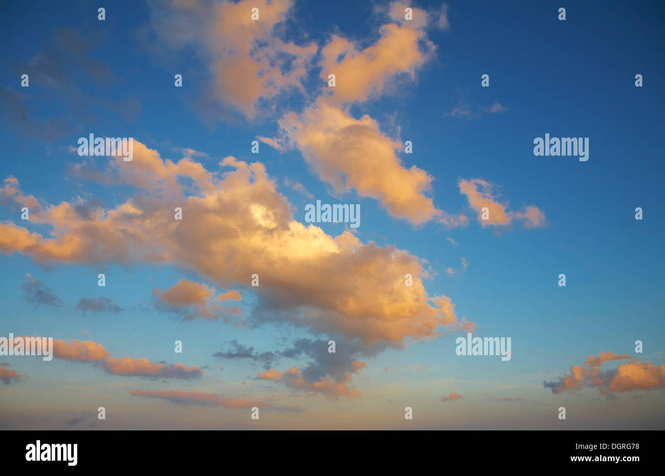 Blue sky with clouds in the evening light - Stock Image