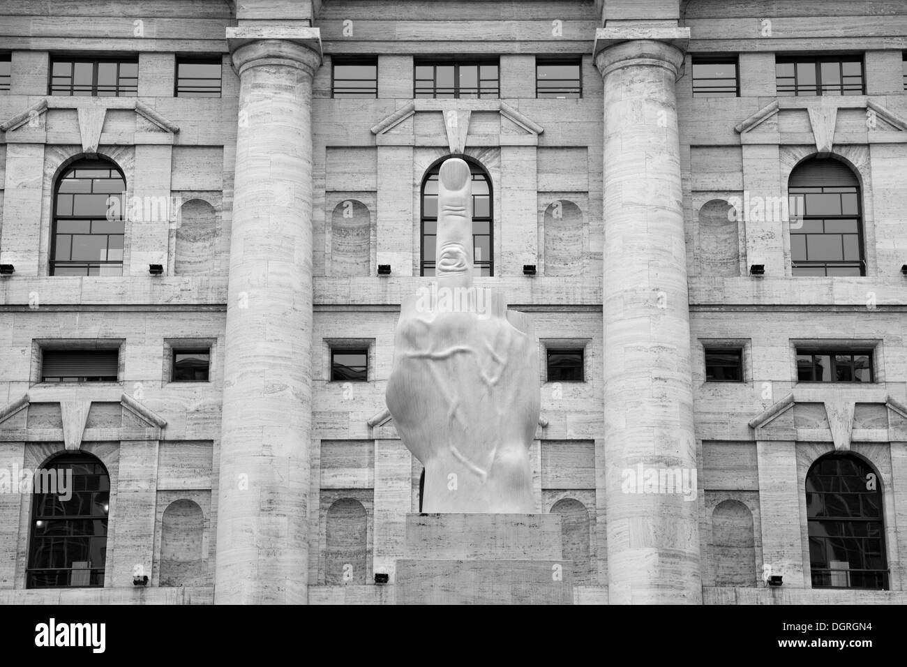 Italy, Lombardy, Milan, sculpture 'crippled hand' by Maurizio Cattelan in front of the Stock Exchange - Stock Image