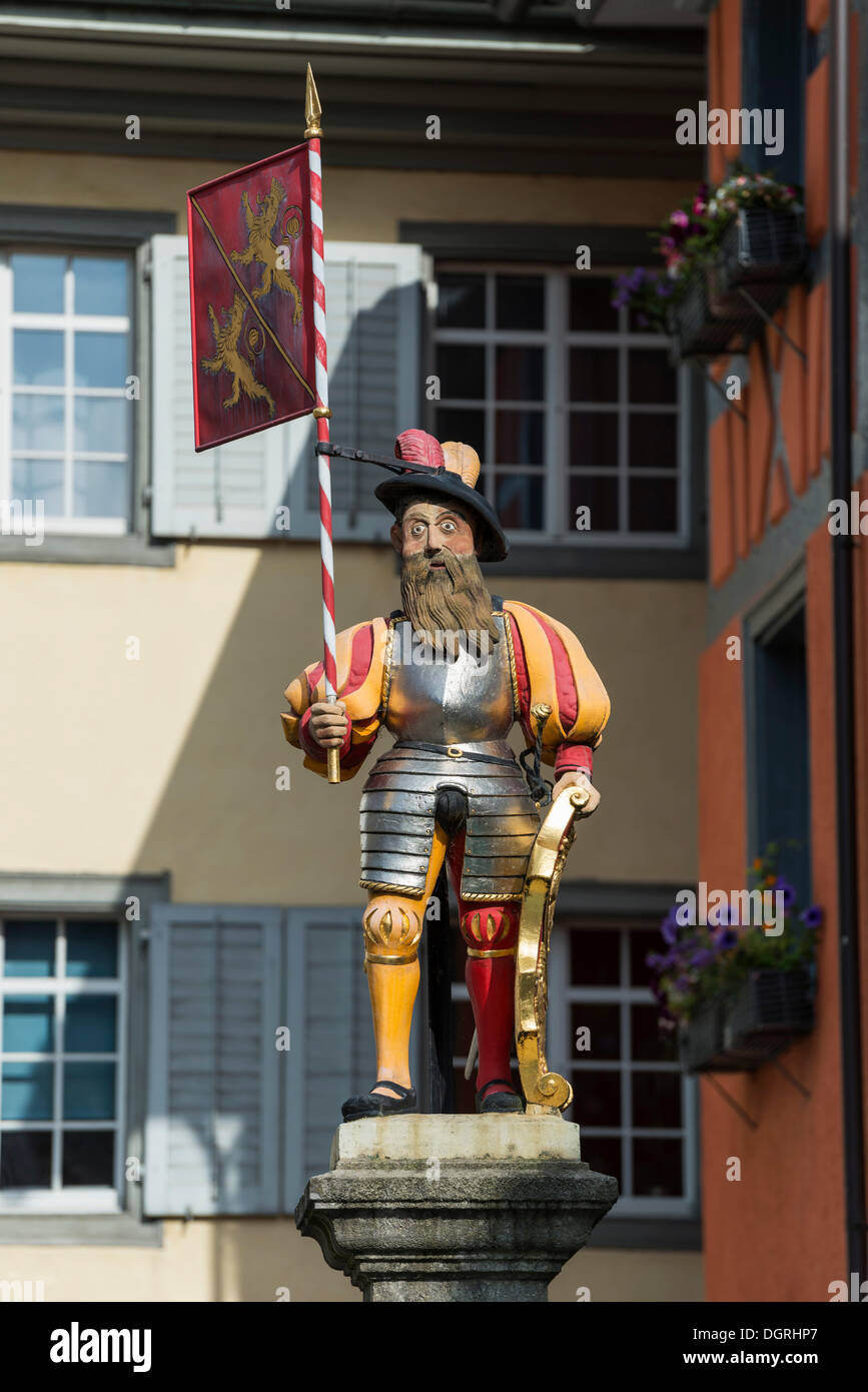 The legendary flagbearer on the pedestal of the fountain in the old town of Diessenhofen, Canton Thurgau, Switzerland, Europe - Stock Image