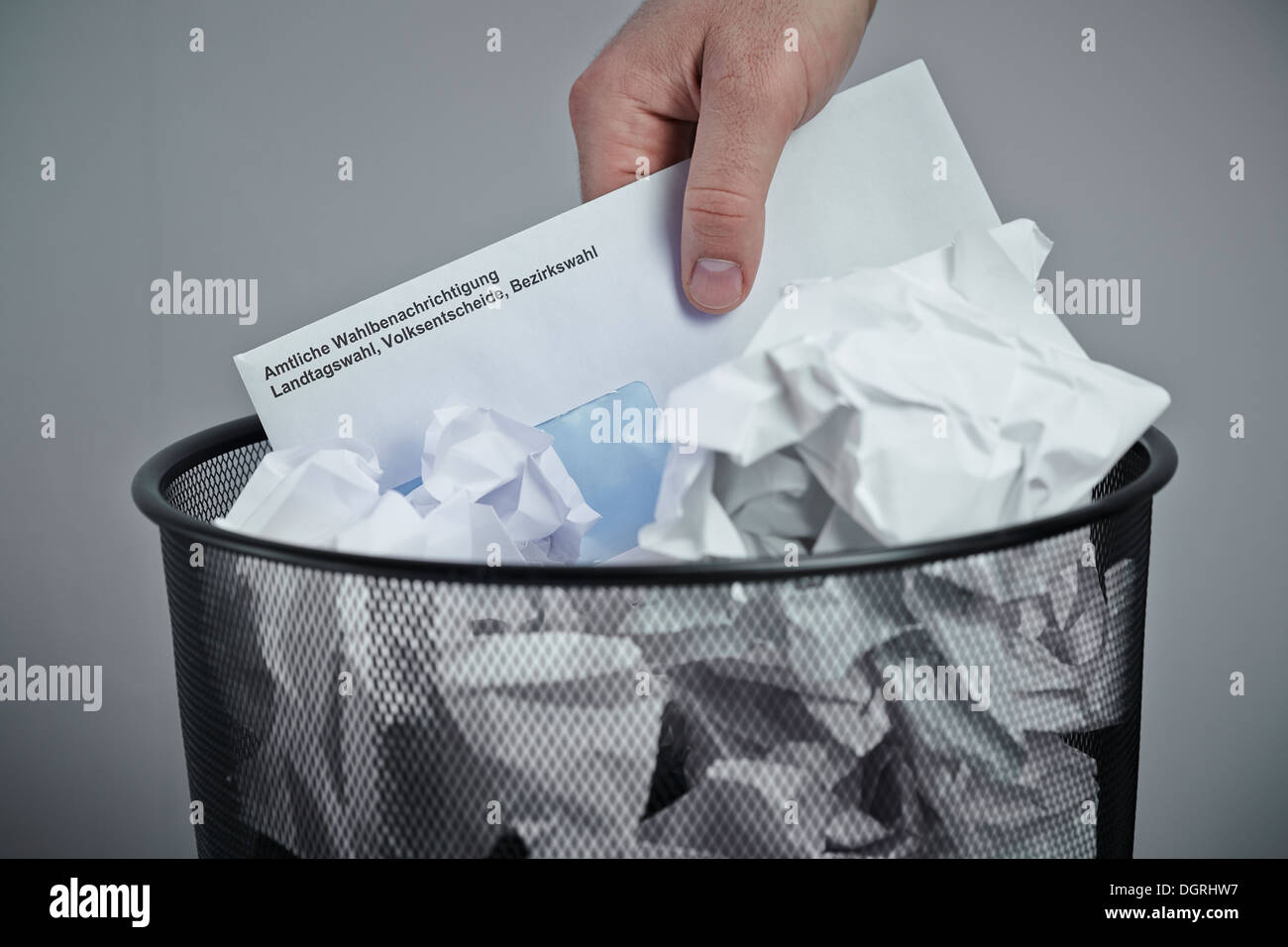 Election voting card in wastepaper basket - Stock Image