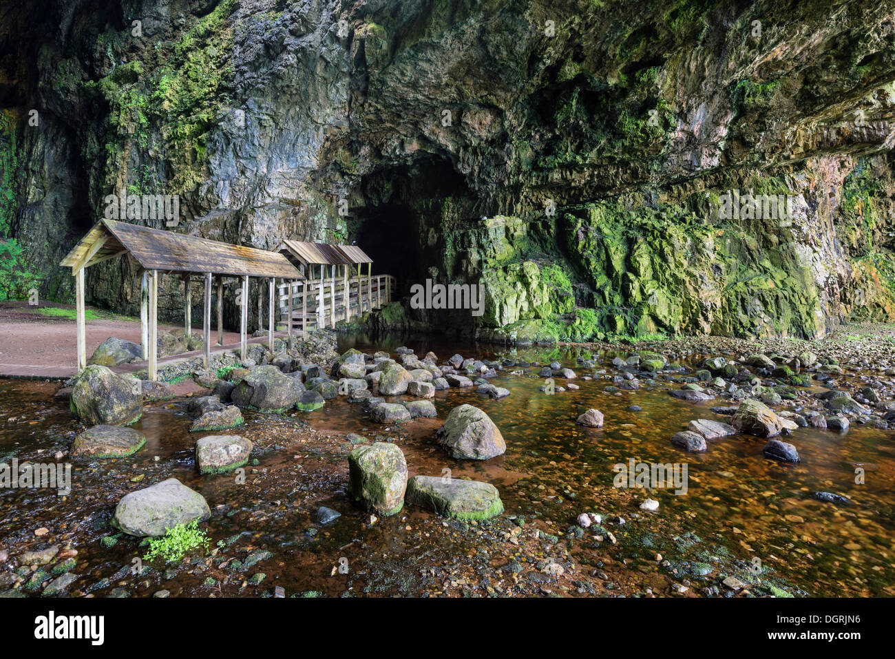 Covered bridge leading into the partly flooded with water Smoo Cave limestone cave, Durness, Northern Highlands Stock Photo