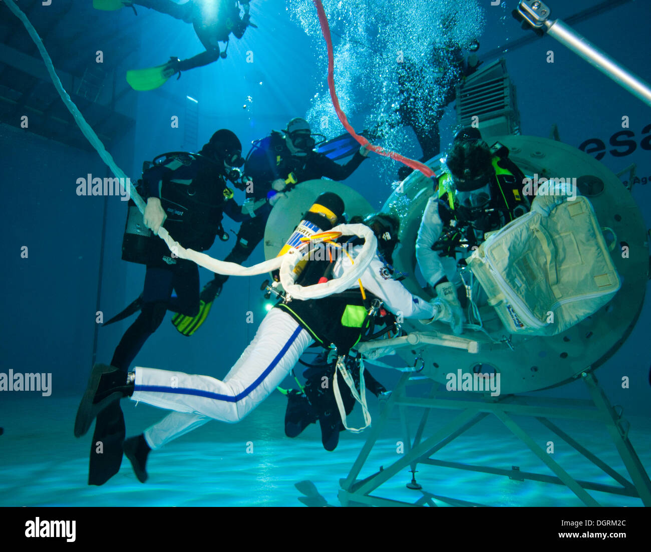 Backup divers and astronauts practicing with a space station module reproduction in a diving basin, European Space Agency, ESA - Stock Image