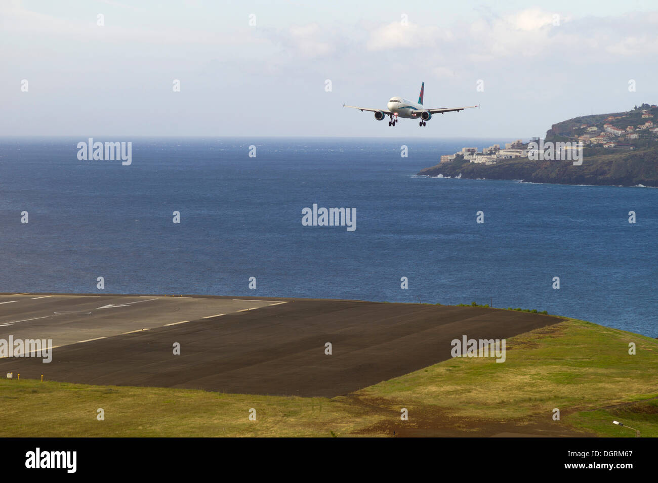 Landing approach of a passenger plane of 'First Choice Airways' at the airport of Madeira, LPMA, Funchal Airport or Airport - Stock Image