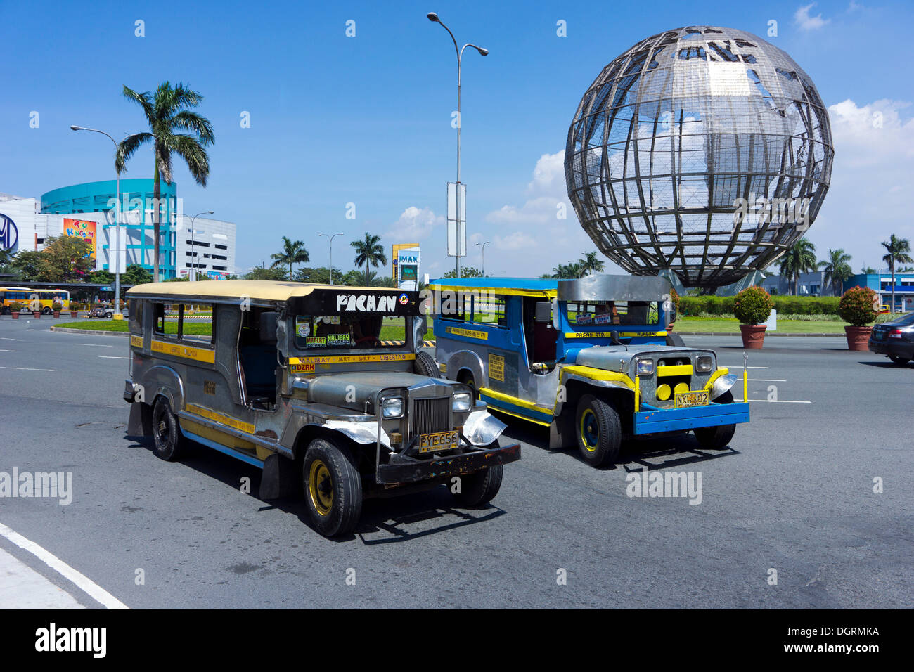 Jeepneys in front of the Mall of Asia, Pasay City, Manila, Philippines, Asian, PublicGround - Stock Image