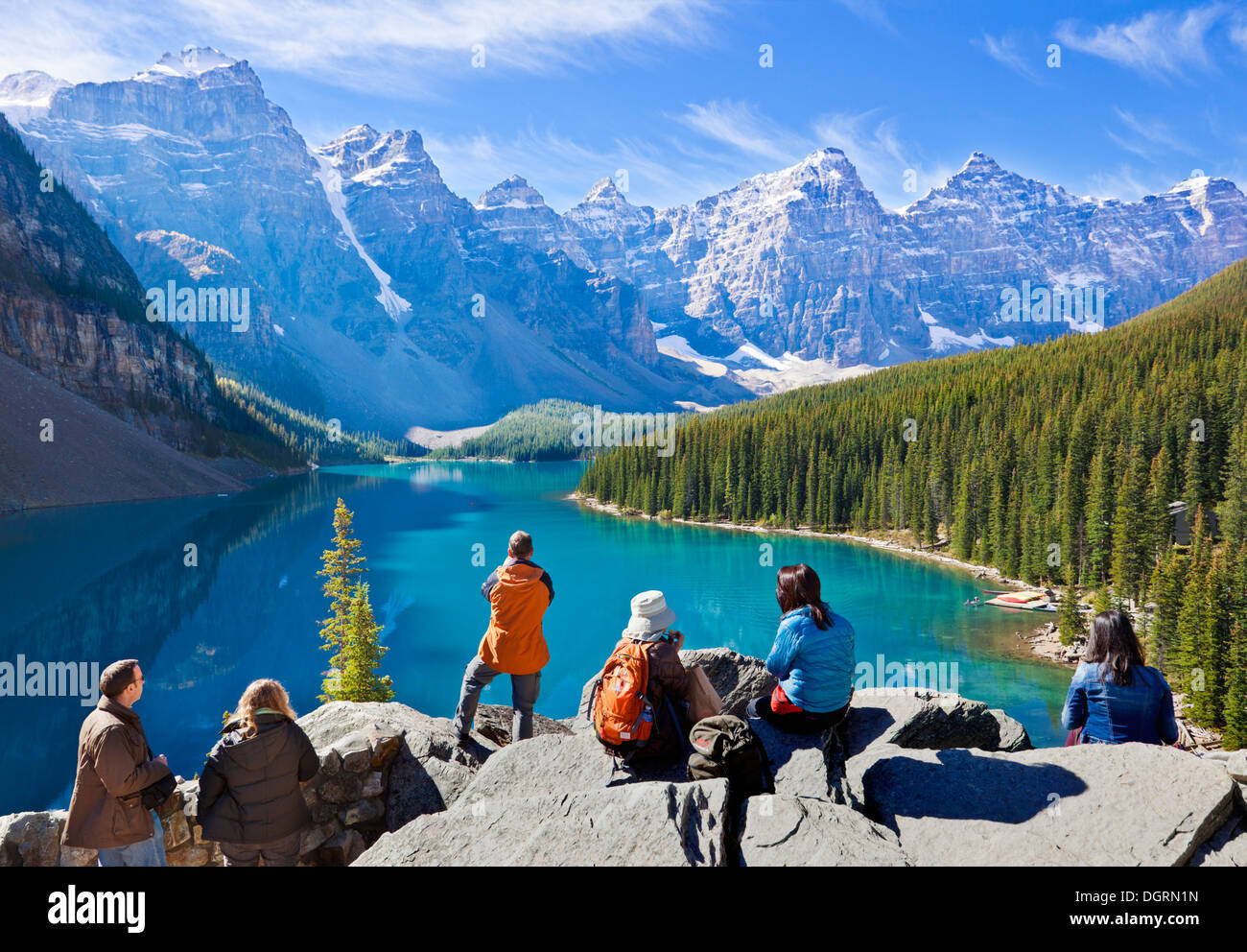 Tourists looking at Moraine lake in the Valley of the Ten Peaks Banff national park Alberta Canada - Stock Image
