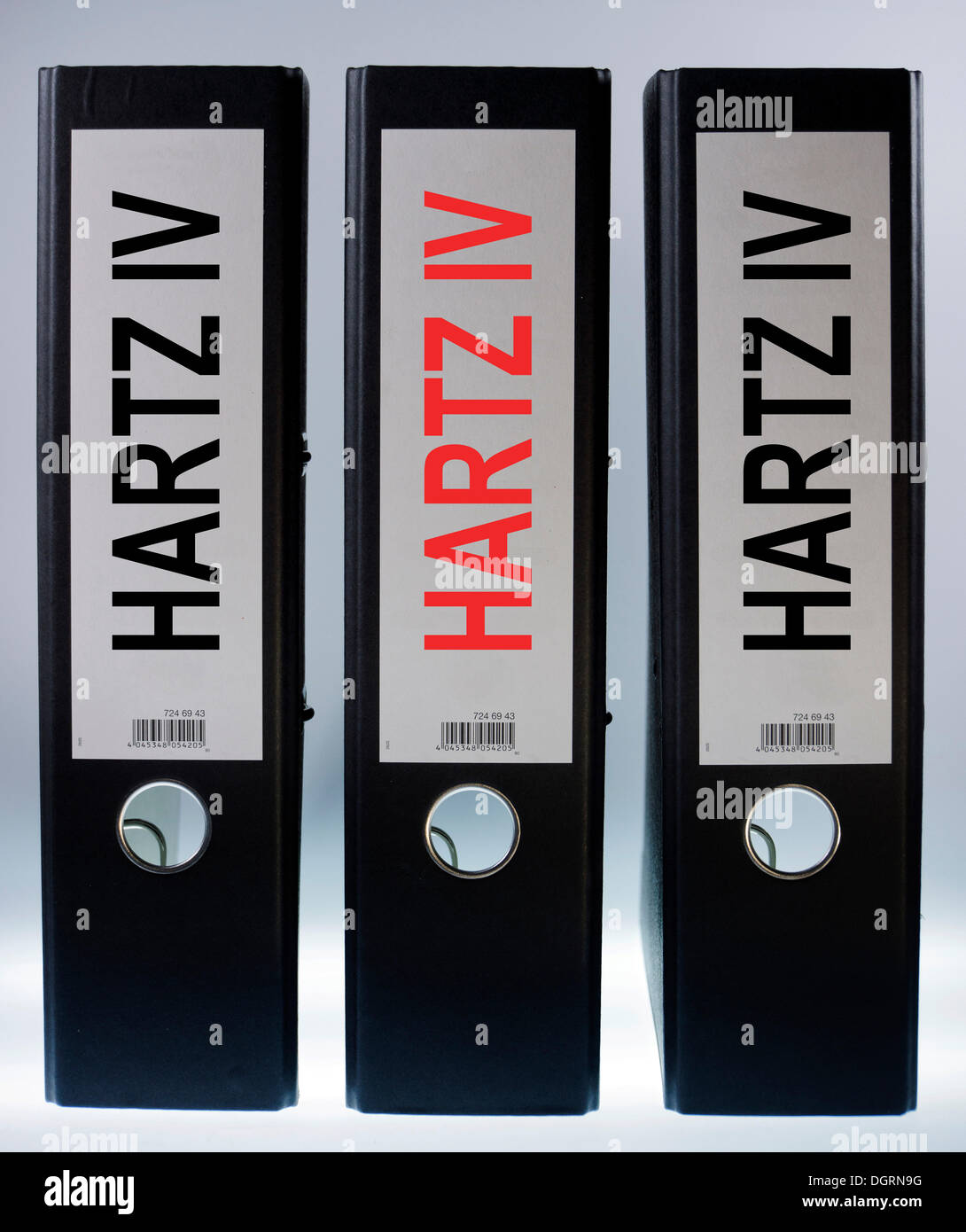 Three ring binders labeled Hartz IV, German term for long-term unemployment benefits, symbolic image - Stock Image