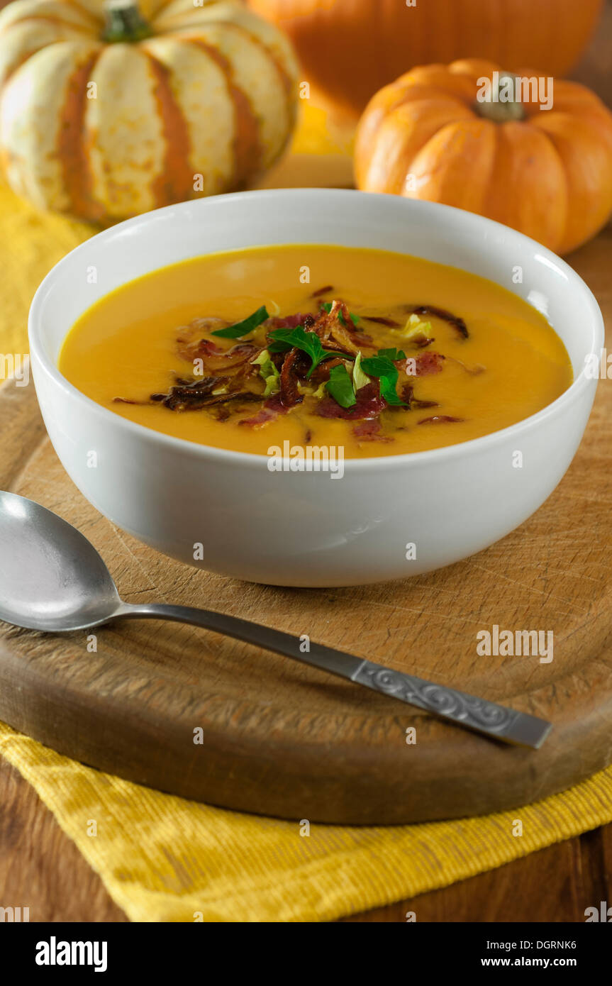 Pumpkin soup with crispy bacon and onions Stock Photo