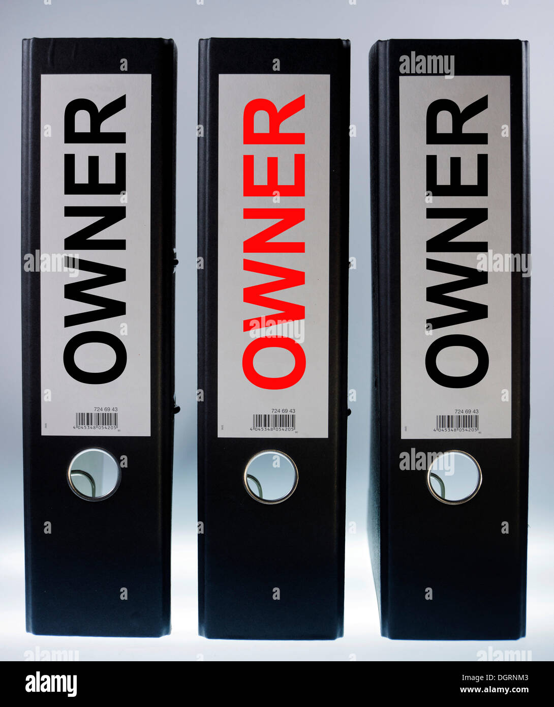 Three file folders labeled 'Owner' - Stock Image