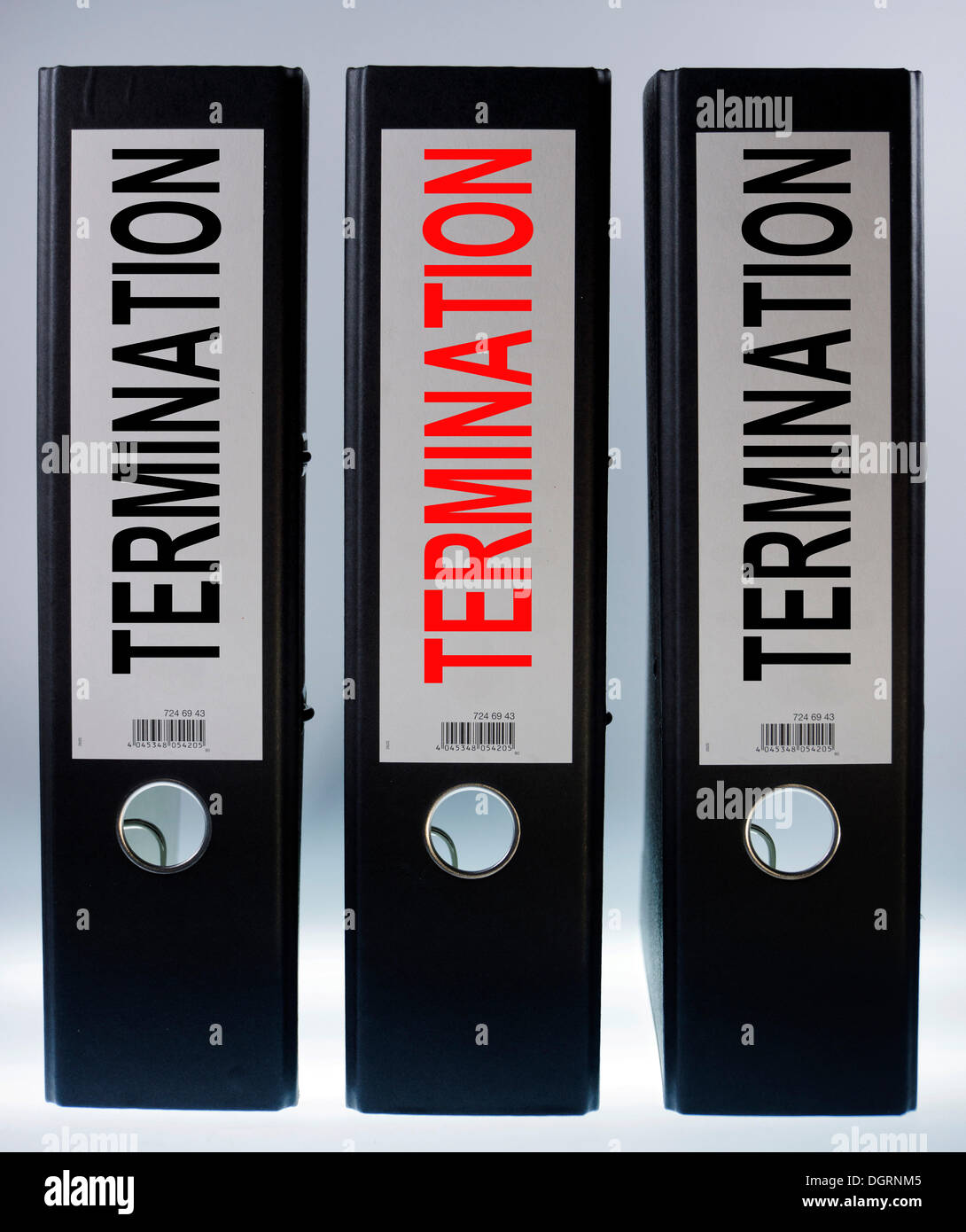 Three ring binders labelled 'TERMINATION' - Stock Image
