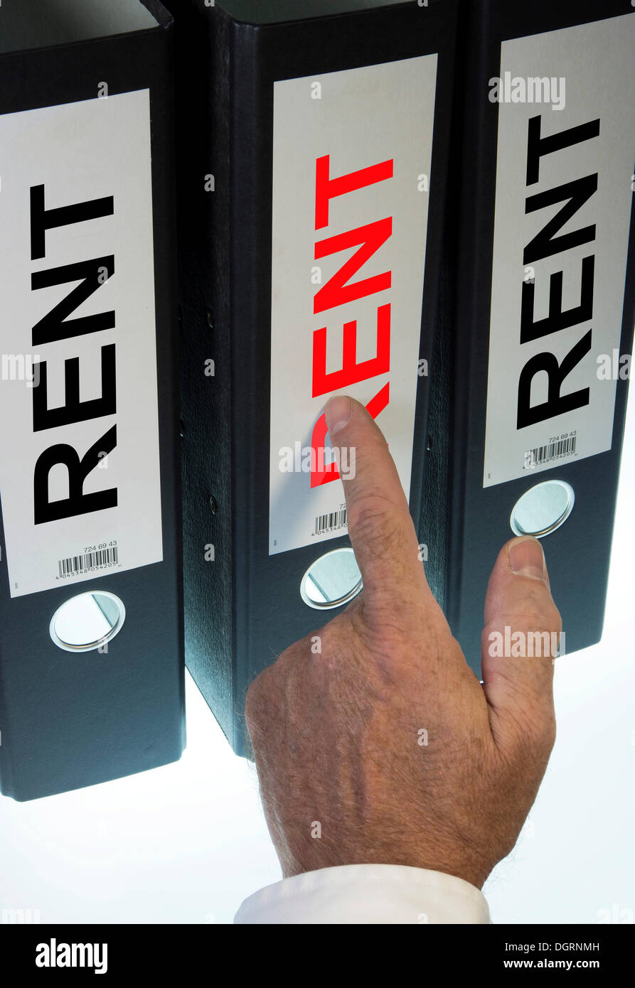 Hand pointing to a file folder labeled 'Rent' - Stock Image