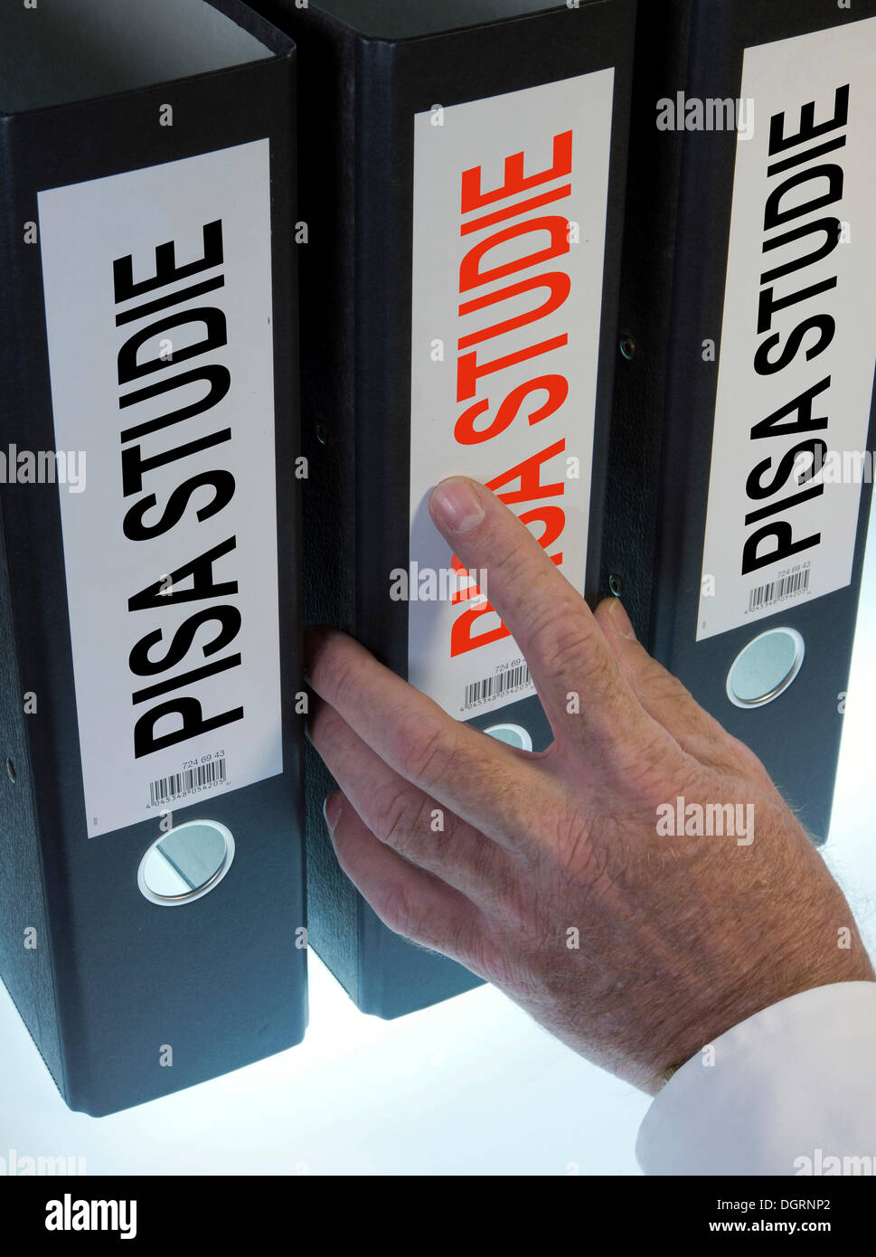 """Hand reaching for a file folder labeled """"PISA-Studie"""", German for """"Programme for International Student Assessment, Stock Photo"""