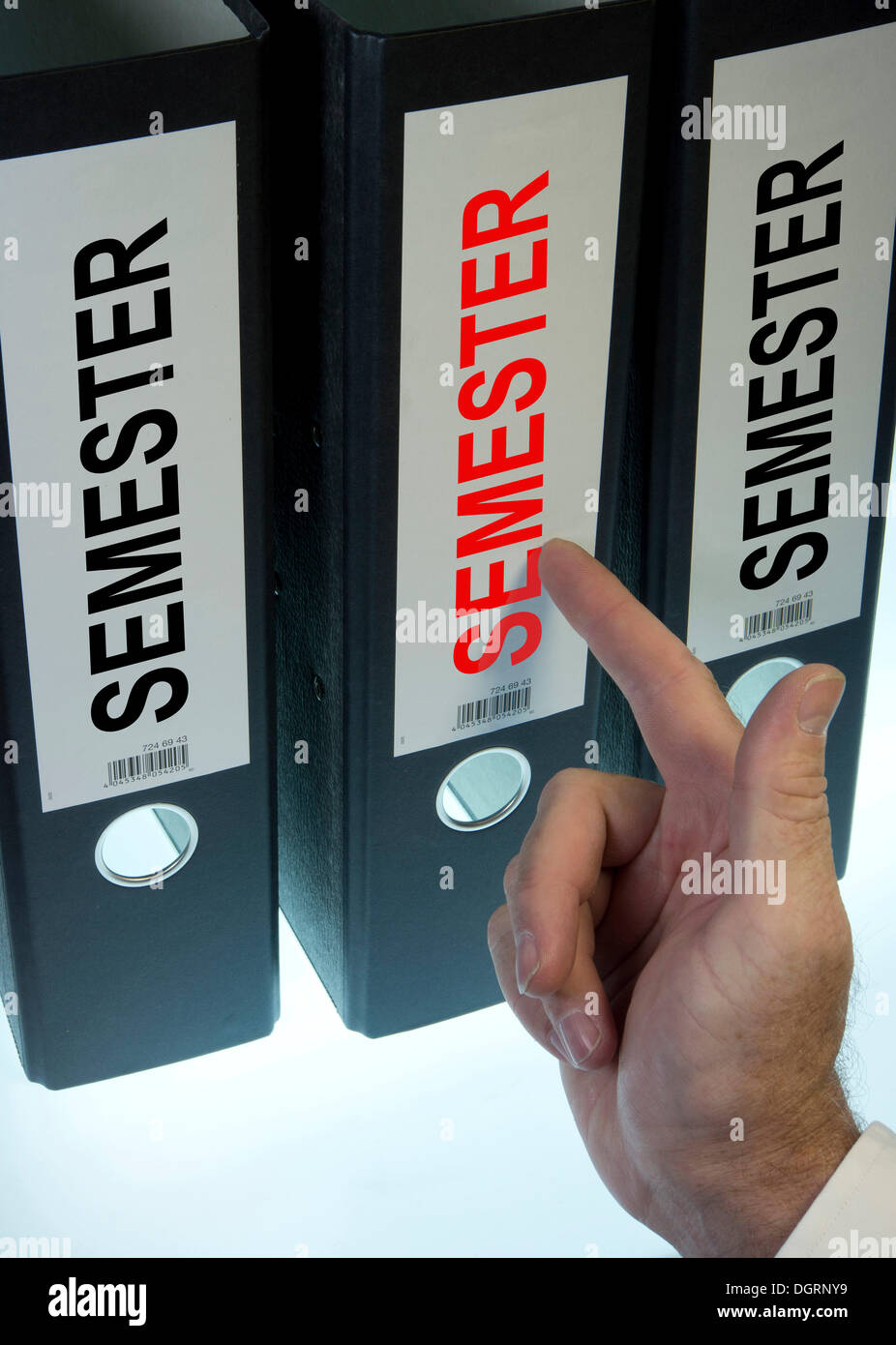 Hand pointing to a file folder labeled 'Semester' - Stock Image