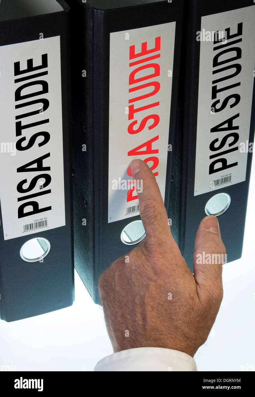 """Hand pointing to a file folder labeled """"PISA"""", German for """"Programme for International Student Assessment, PISA"""" Stock Photo"""