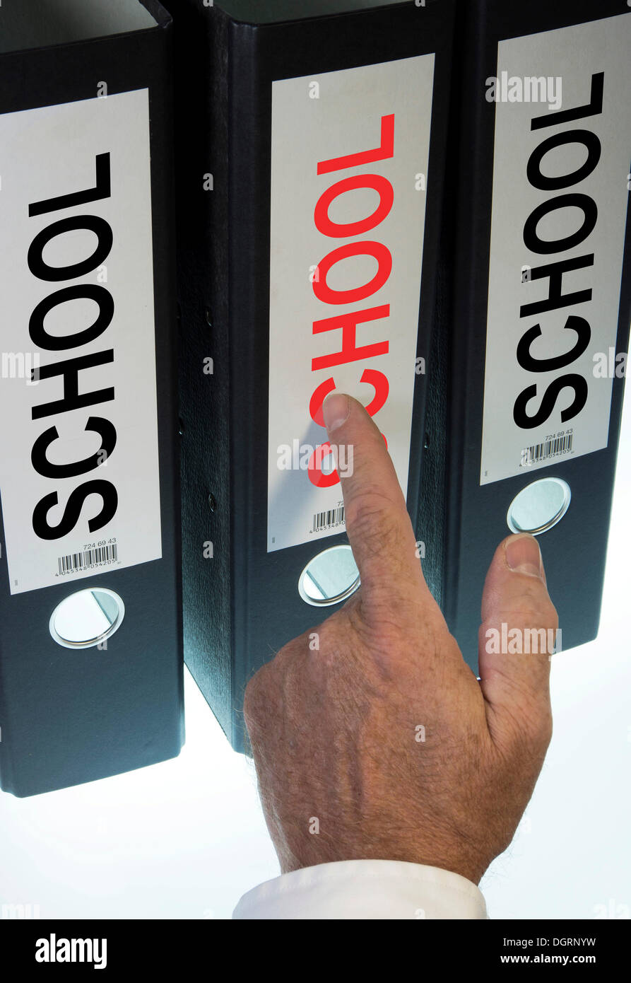 """Hand pointing to a file folder labeled """"School"""" - Stock Image"""