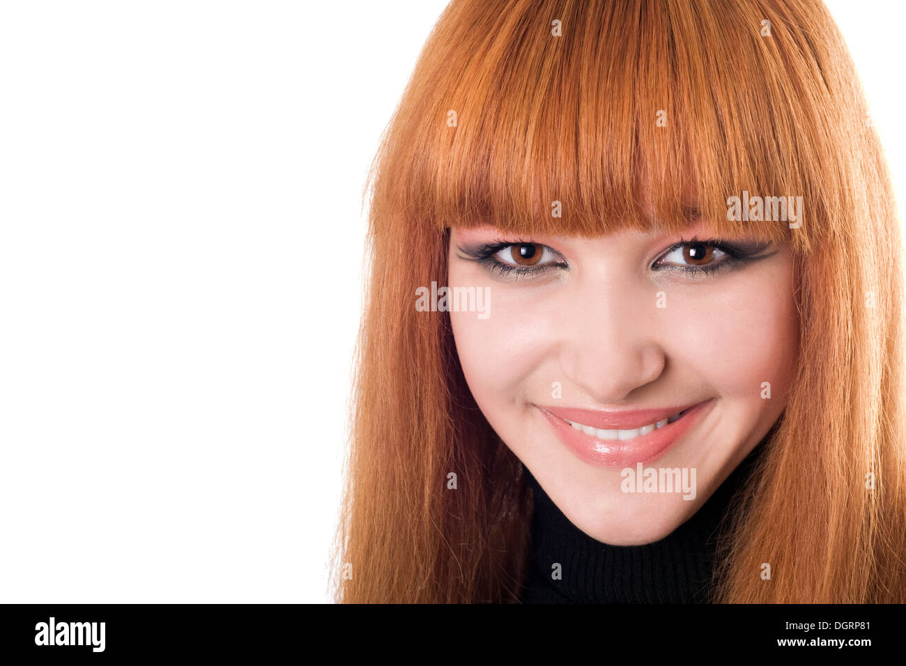 Portrait of the beautiful smiling redheaded woman - Stock Image