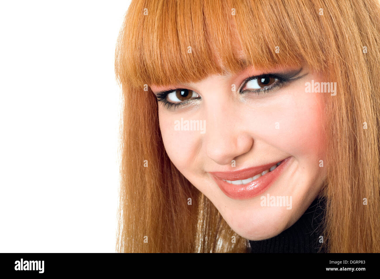 Portrait of the pretty smiling redheaded woman - Stock Image