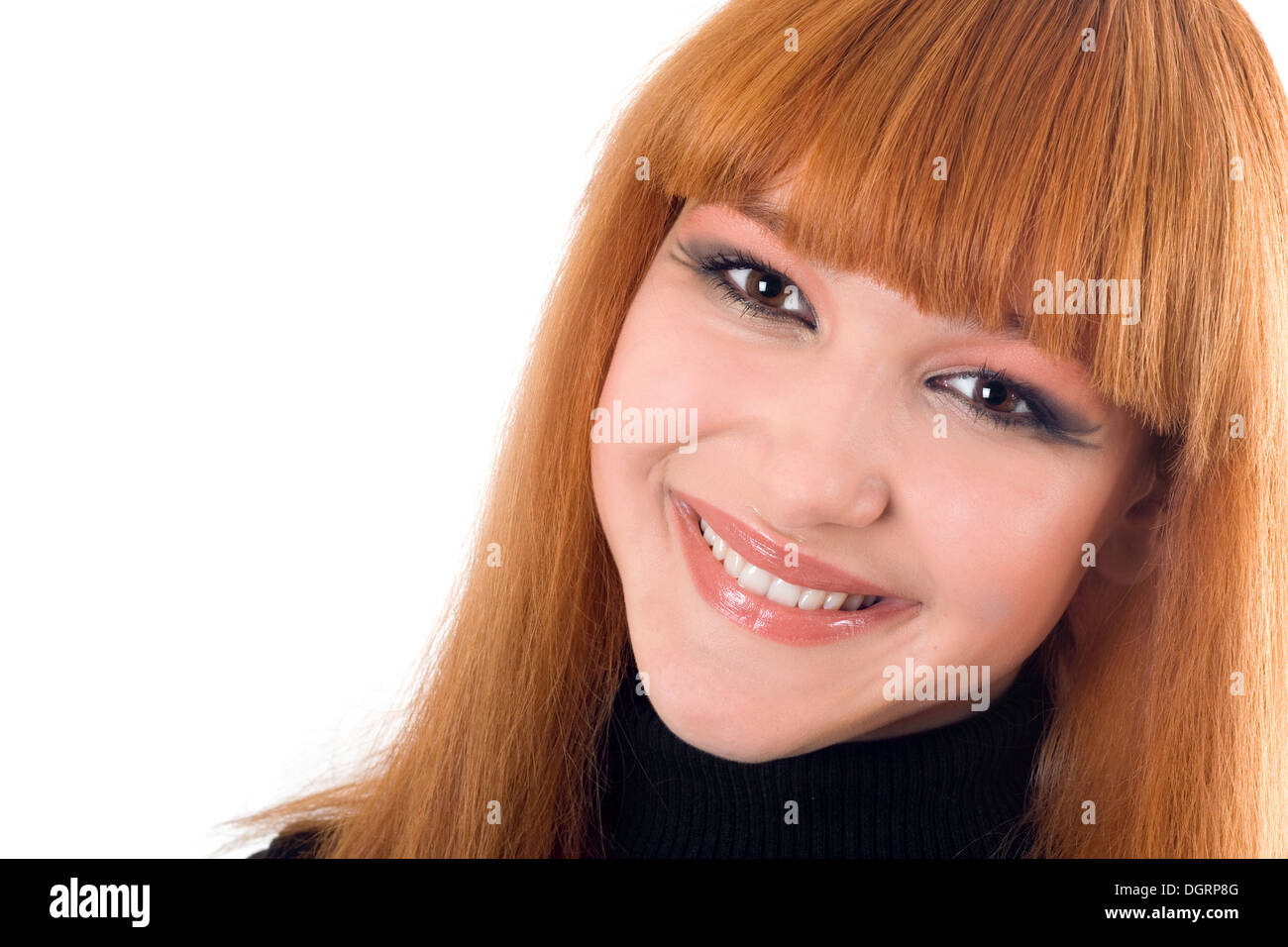 Portrait of the attractive smiling redheaded woman - Stock Image