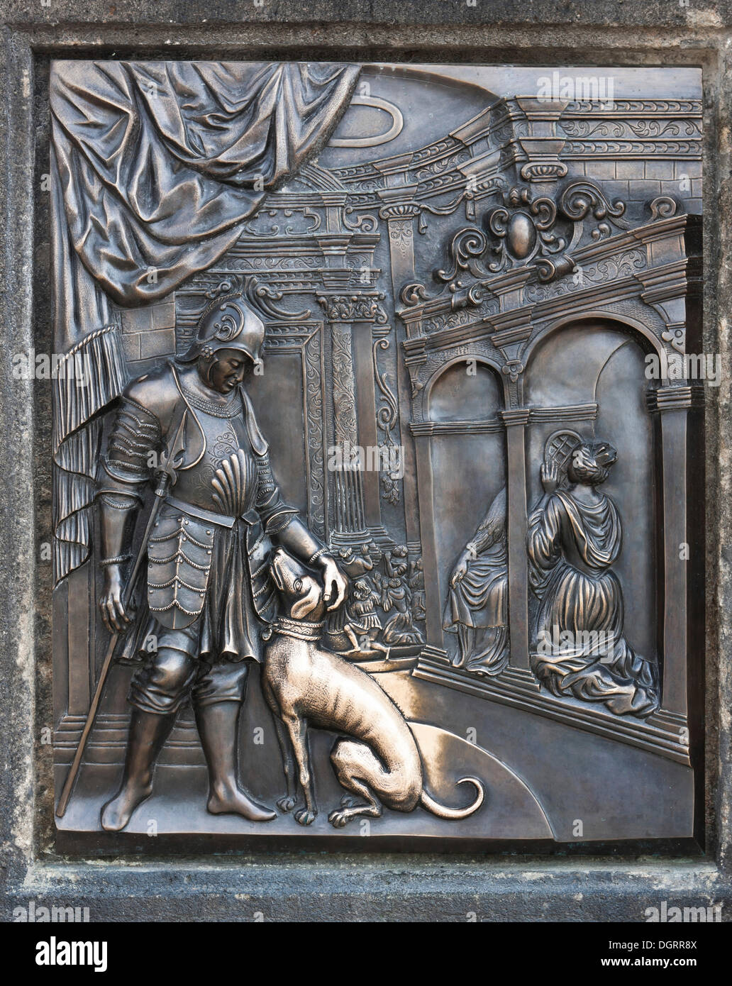 Bronze relief, Aristocrat with Dog, on the statue of St. John Nepomuk, Charles Bridge, Prague, Czech Republic, Europe - Stock Image