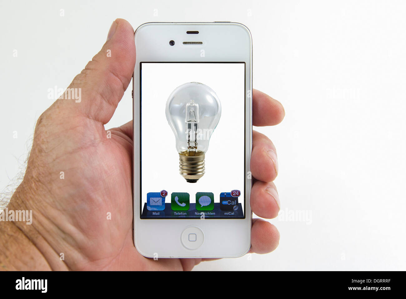 Light bulb on the screen of a smartphone, symbolic image for Stock ...