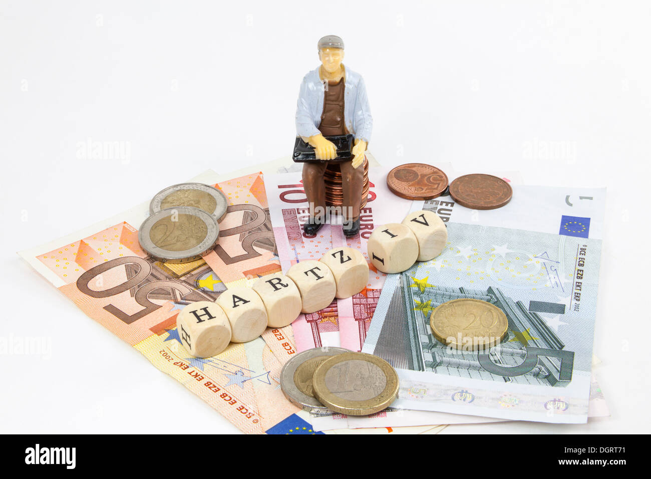 Miniature figure of a worker, Euro banknotes, letter cubes forming the word 'Hartz IV' German income support subsidy, symbolic - Stock Image