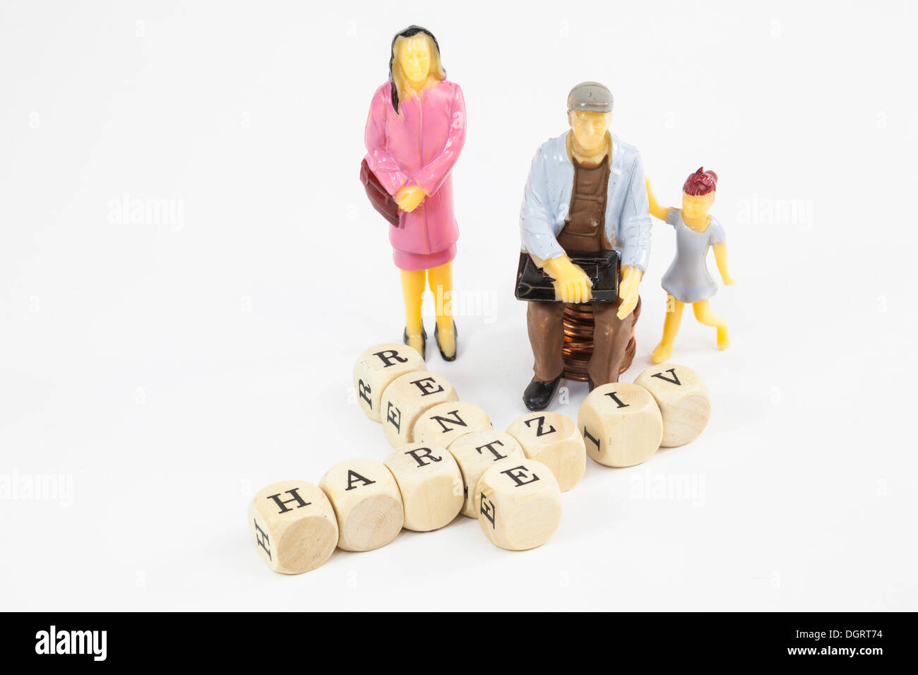 Miniature figures and letter cubes, working class family receiving the 'Hartz IV' German income support subsidy and a pension - Stock Image