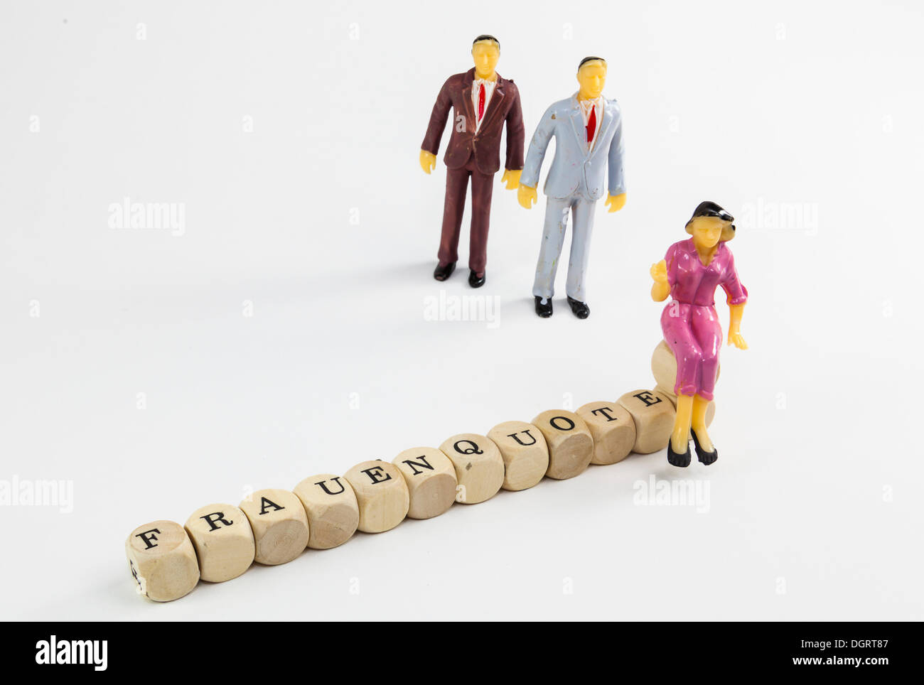 Miniature figures, cubes with letters forming the word 'Frauenquote', German for 'female quota' - Stock Image
