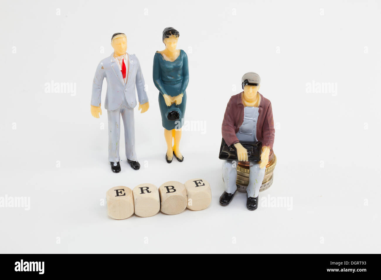 Miniature figures, letter cubes forming the word 'Erbe', German for 'inheritance', symbolic image - Stock Image