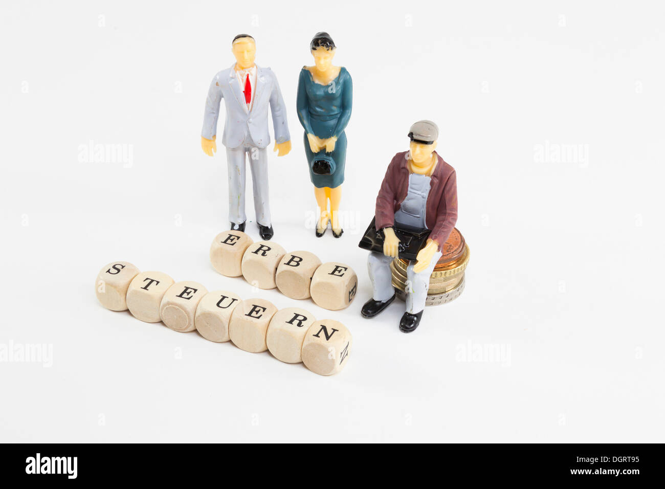 Miniature figures, letter cubes forming the words 'Erbe' and 'Steuern', German for 'inheritance' and 'taxes', symbolic image for - Stock Image