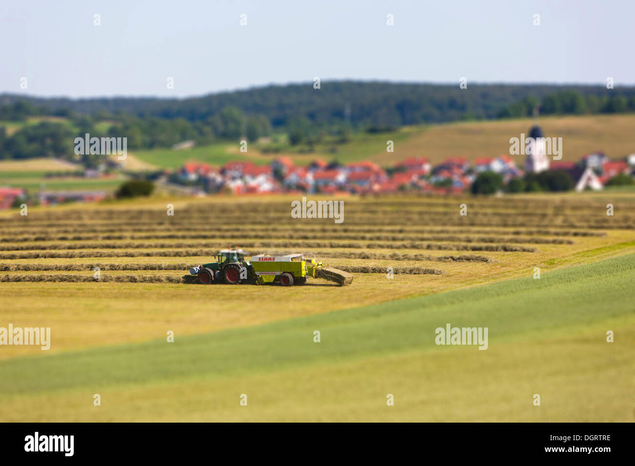 Agricultural machine working in the fields, tilt-shift effect, Honau, Baden-Wuerttemberg, PublicGround - Stock Image