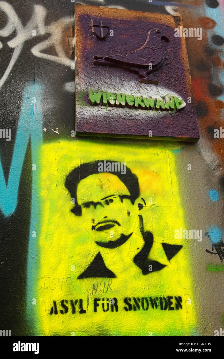 Graffiti at Frans-Josefs-Kai, Danube Canal, street art  featuring former  NSA computer  specialist  Snowden,  Vienna, Austria - Stock Image