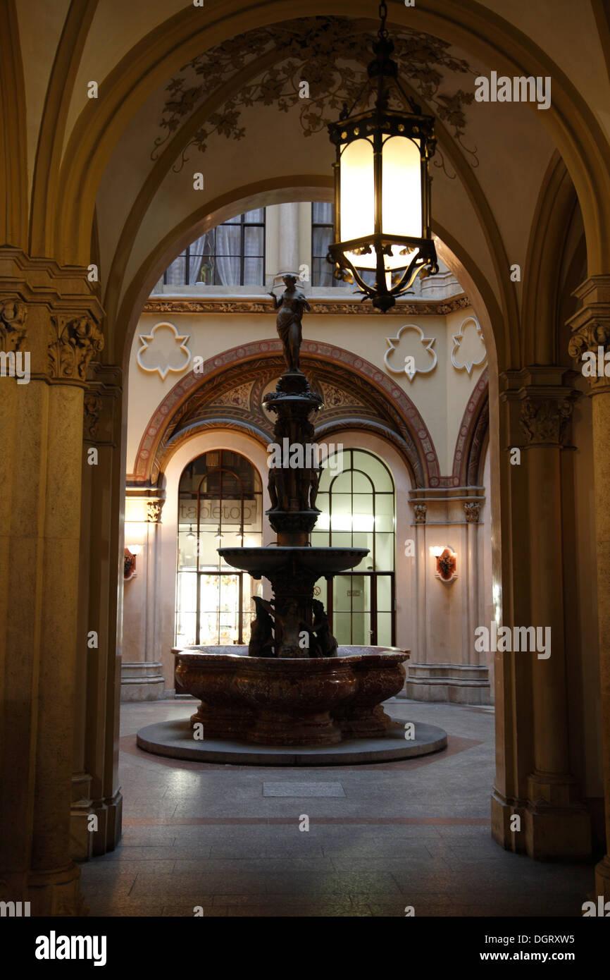 Fountain in Freyung Passage at Ferstel Palais, Vienna, Austria, Europe - Stock Image