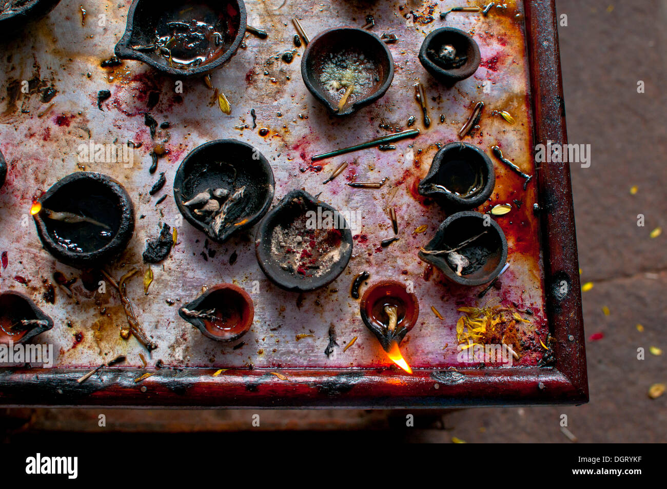 Oil lamps in an Indian temple Stock Photo