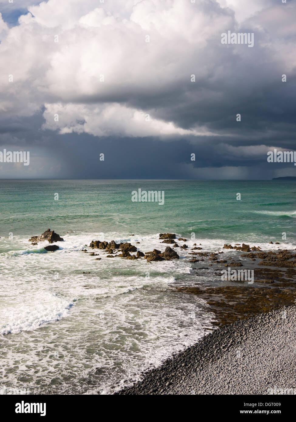 Summer rainstorm over the Atlantic Ocean viewed from Cornborough range on the North Devon coast near Abbotsham, England. - Stock Image