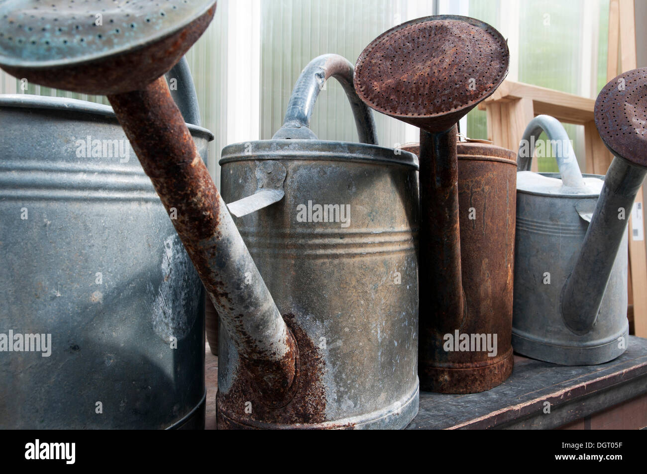 Watering cans made of galvanized sheet metal, rusty - Stock Image