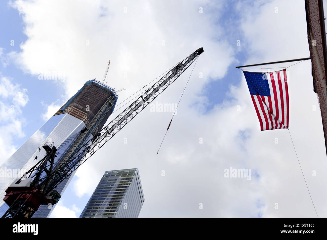 NEW YORK CITY- One World Trade Center building, still under construction and the American Flag, January 2, 2012 - Stock Image