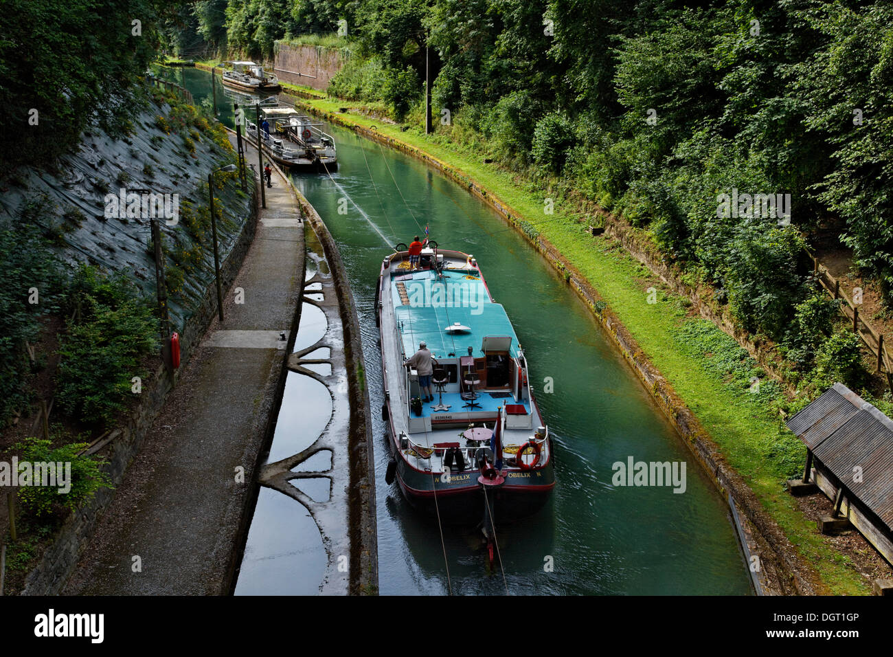 Tunnel of Riqueval for the Canal of Saint-Quentin, the towboat travels along a chain and can pull multiple ships through the - Stock Image