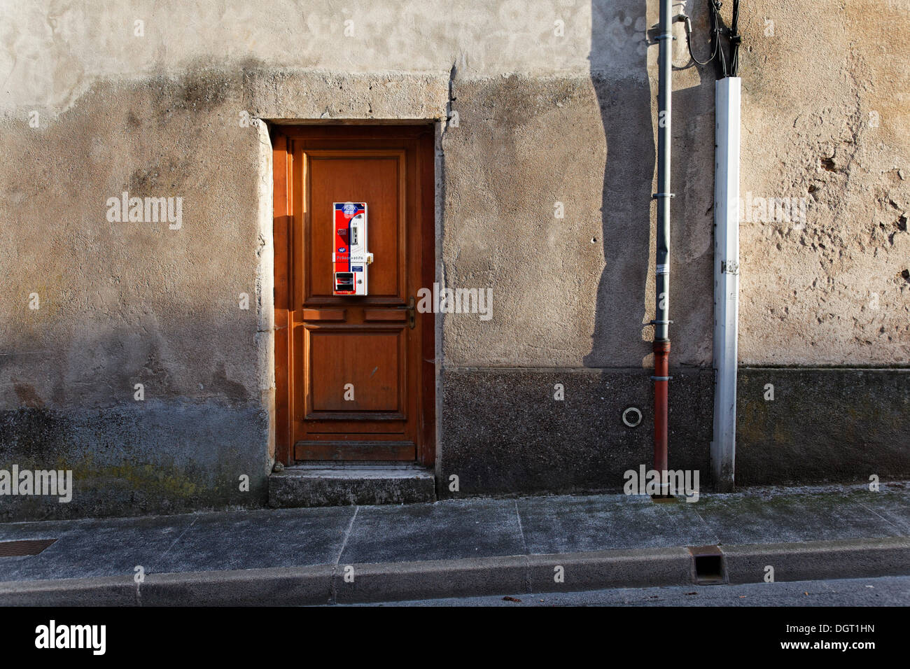 Condom vending machine on the door of a house, historic town centre of Langres, department of Haute-Marne - Stock Image