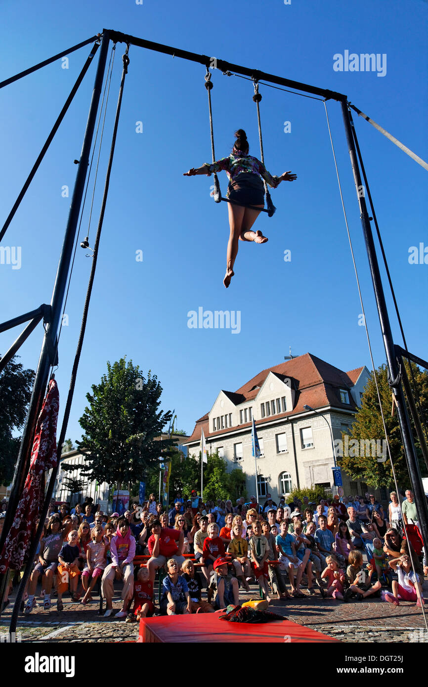 The third Brueckensensationen street theatre festival, Andrea Beck performing as Madame Nathalie on the trapeze - Stock Image