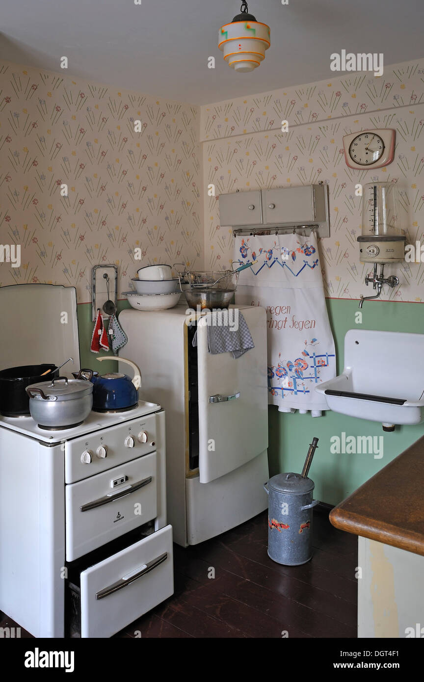 Kitchen of the 1950s with a stove, a refrigerator, a sink and a hot water boiler, industrial museum, Lauf, Middle Franconia - Stock Image